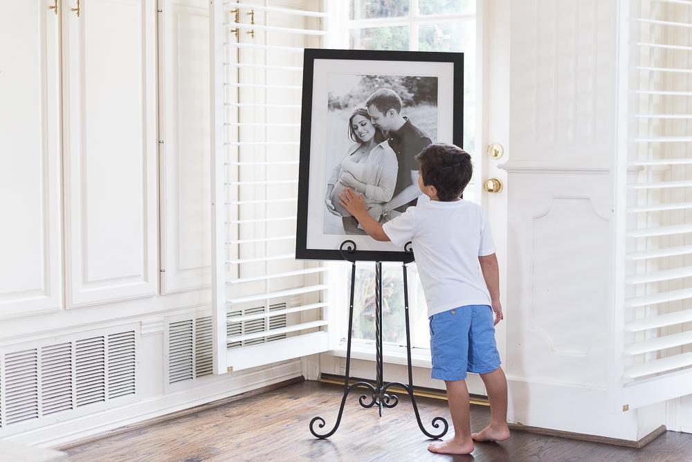 Little boy touching pregnant belly in framed portrait by Keli Melo